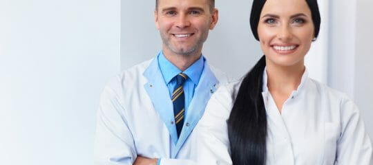 A Male and female doctor standing