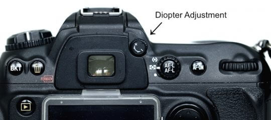 DSLR camera with diopter dial indicated