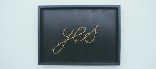 The word Yes written on blackboard