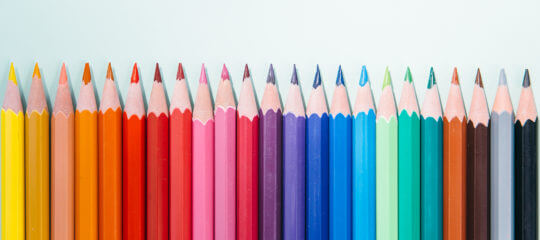 palette of colored pencils in a row