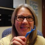 Dr. Lee Ann Brady holding Spotit contact marker
