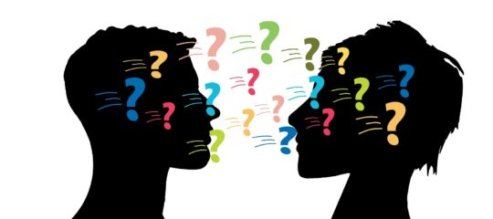 two people's silhouette facing each other with question marks