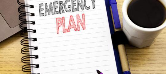 Notebook with emergency plan written on it