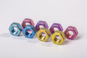 multiple aluminum nuts anodized in various colors
